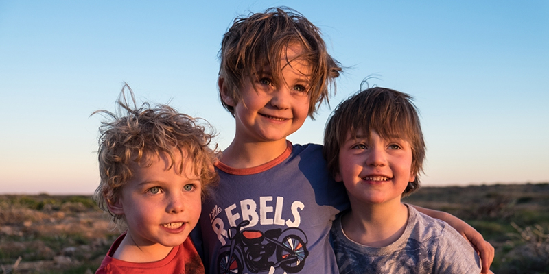 photo of 3 young boys