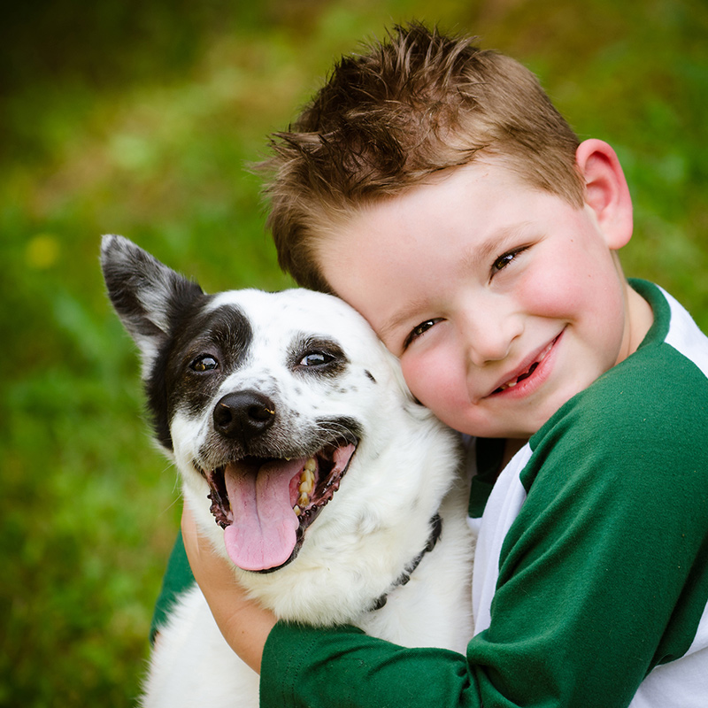 young child holding his dog